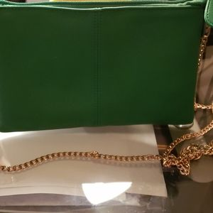 Clutch with shoulder strap or wrist